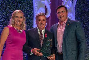 Chris Christini receiving an award