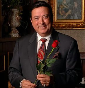 Chris Christini, owner of the best Italian restaurant in Orlando, holding a red rose